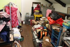 Messy Home. A cluttered house where there are clothes, books, and bags everywhere Stock Images