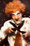Messy Homicidal Clown In Bloody Horror Massacre Stock Photos