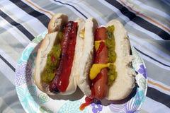 Messy hotdog / hot dog on buns with relish, ketchup and mustard Stock Photo