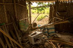 Messy Junk in Abandoned Chicken Coop - Old Plastic Chair - Wood, Hose and Basket - Asian Tree House and Garden royalty free stock photo