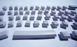 Messy keyboard. Keys from a computer keyboard arranged in a messy pattern stock photography