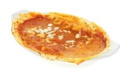 Messy lasagna tv dinner in baking dish Stock Photography