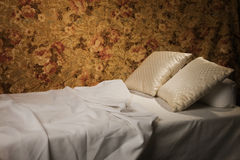 Messy luxurious bed with pillow Stock Images
