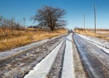 Messy muddy road. Slush, icy, snowy dirt road Stock Photos