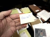 Messy Office with Clean Up Note Royalty Free Stock Photography