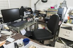 Messy Office Desk. Messy business office desk with piles of files and disorganized clutter royalty free stock photography