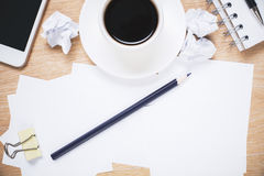 Messy office desktop. With paperwork, coffee cup and smartphone Stock Photo
