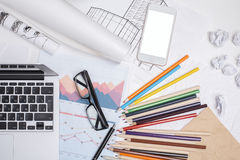 Messy office desktop with white smartphone Royalty Free Stock Photo
