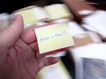 Messy Office with Make a Plan Note Stock Photo