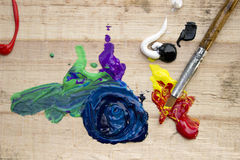 Messy paint and paintbrush Royalty Free Stock Images