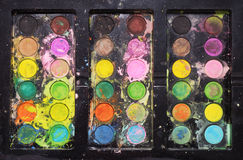 Messy paint palette Stock Photo
