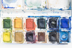 Messy paintbox. Close-up of messy watercolor paintbox royalty free stock photography
