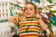 Messy painted boy pointing Stock Photography