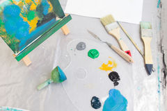 Messy painter workplace top view. Art studio Royalty Free Stock Photo