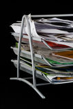 Messy paper tray with papers. Paper tray overflowing with papers,mail and other documents. Isolated on black background royalty free stock photography