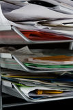 Messy paper tray with papers. Paper tray overflowing with papers,mail and other documents. Isolated on black background royalty free stock images