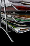 Messy paper tray with papers. Paper tray overflowing with papers,mail and other documents. Isolated on black background stock images