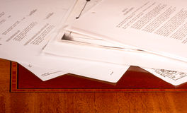 Messy papers on desk Stock Image