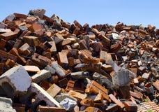 Messy pile of bricks on blue sky Stock Photo