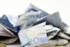 Messy pile of euro banknotes and coins Royalty Free Stock Photos