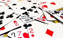 Messy of Playing Cards with White Background. A playing card is a piece of specially prepared heavy paper, thin cardboard, plastic-coated paper, cotton-paper Stock Photo