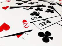 Messy of Playing Cards with White Background. A playing card is a piece of specially prepared heavy paper, thin cardboard, plastic-coated paper, cotton-paper Royalty Free Stock Photos