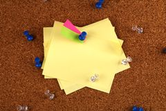 Messy post it notes on cork board Stock Photography