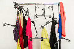 Messy rack of clothes and hangers. Royalty Free Stock Photography