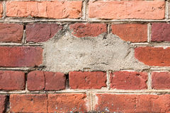Messy red brown brick wall Stock Photo