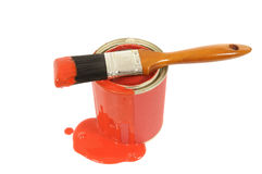 Red paint, spilled, puddle, paint can, paintbrush, isolated on white background Royalty Free Stock Images