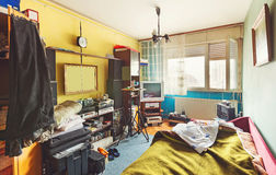 Messy room. Interior, a lot of different stuff, from electronic appliances and furniture to clothes stock photo