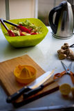 Messy salad preparation. On kitchen table Royalty Free Stock Photo