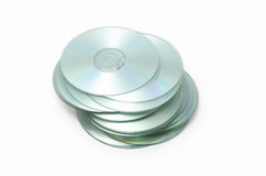 Really messy stack of CD disks on white. Tall very messy stack of CD disks on white background Stock Image