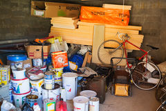Messy storage room. With cans and bicycle Stock Photo