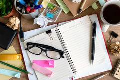 Messy Table with Blank Note and Tools Royalty Free Stock Photos