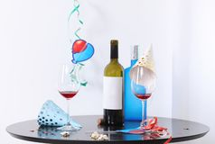 Messy table with bottles and glasses against white background. After party chaos royalty free stock image