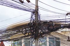 Messy tangle electricity wire and communication cables in Thaila stock images