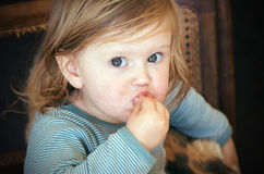 Messy toddler eating Stock Photography