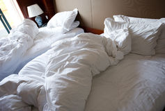 Messy unmade bed Stock Photography