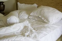 Messy unmade bed. With pillow and quilt cover Stock Photography