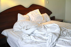 Messy unmade bed in hotel room Royalty Free Stock Photography