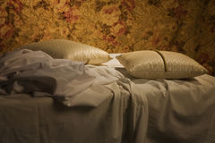 Messy unmade bed with pillow and quilt cover Stock Photography