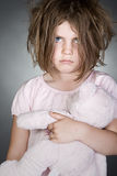 Messy Upset Child Gripping her Teddy Bear Royalty Free Stock Images