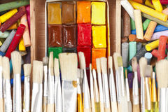 Messy, used water-color paint-box with. Closeup of messy, used water-color paint-box with buishes and dry pastel Royalty Free Stock Photo