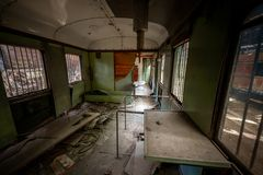 Messy vehicle interior of a train carriage. Angle shot Royalty Free Stock Photo