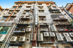 Messy wall of old resident building. Air conditioners install on the messy wall of old resident building in Guangzhou, China, ant view Royalty Free Stock Images