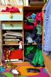Messy wardrobe. Messy drawers filled with clothes stock photography