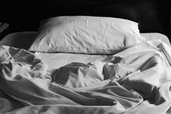 Messy white bed and pillow Royalty Free Stock Image