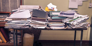 Messy workplace. With stack of old papers stock photography