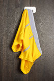 Messy yellow man underwear hanged on the wall Royalty Free Stock Photos
